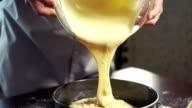Cake batter pouring into baking dish. Home baking. Baking cake video
