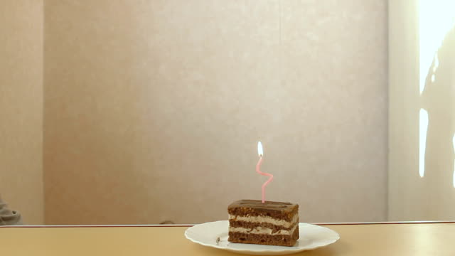 cake with a single candle video