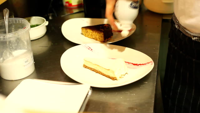Cakes decorated with whipped cream before served video