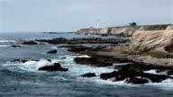 California dramatic rocky Pacific Ocean coast lighthouse HD video