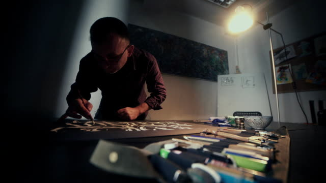 Calligrapher. Calligrapher man with glasses. Workshop calligrapher video