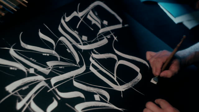 Calligraphic font. Calligrapher s work. Pen for calligraphy video