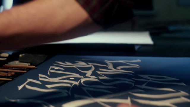 Calligraphy. Calligrapher. Art. Calligrapher writes canvas pen video