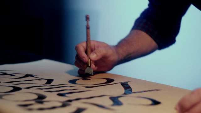 Calligraphy. Calligrapher. Hand of a calligraphy. Wide pen for calligraphy video