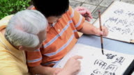Calligraphy Grandfather and Grandson Writing video