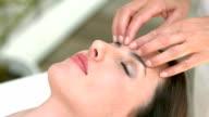 Calm woman receiving reiki treatment video