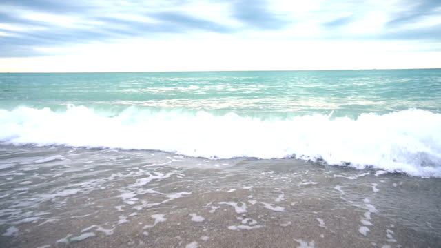 Calming view sea from the shore in cloudy weather video