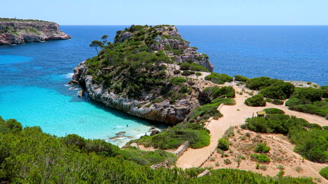 Calo des Moro (Cala de Sa Comuna) on east coast on Spanish Balearic island of Majorca / Spain video