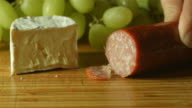 camembert brie cheese cheese and salami platter prep cutting up in kitchen video