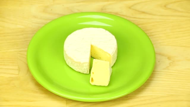 Camembert rotates on a wooden board video