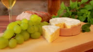 Camembert with white wine, grapes and bread video