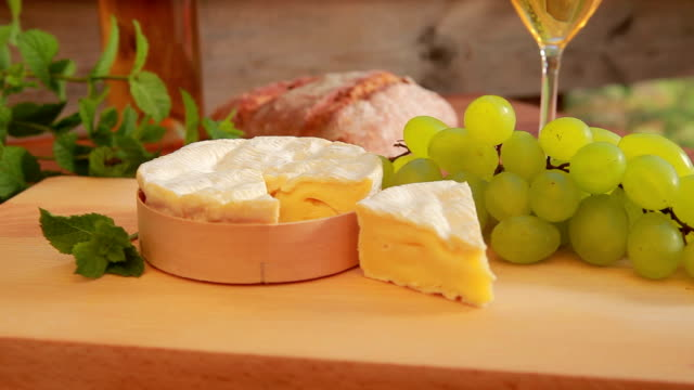 Camembert with white wine, grapes and bread. video