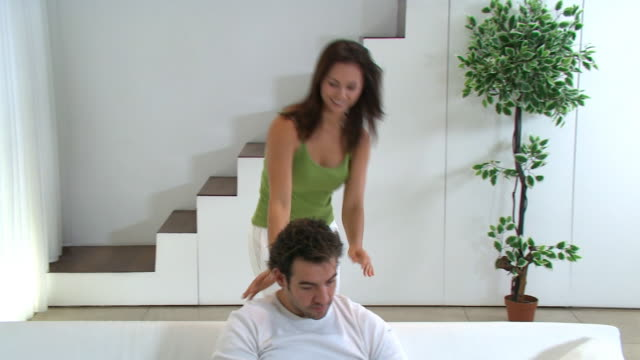 Camera crane shot of young couple in modern home video