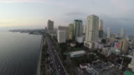 Camera flying over Roxas Boulevard and Manila Bay video