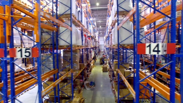 Camera in motion inside a large warehouse, storage. 4K. video