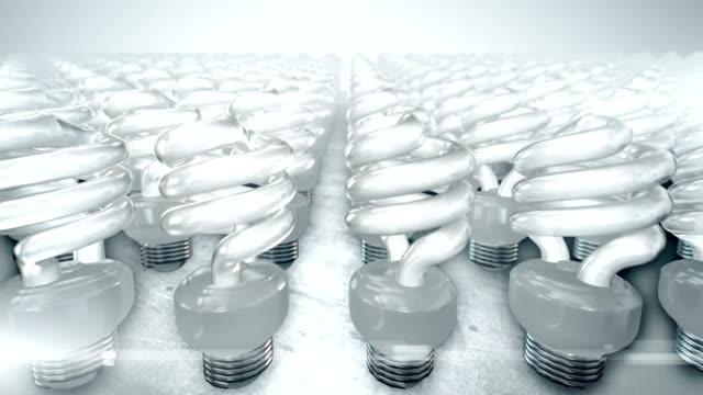 Camera movement over group of energy saving lightbulbs (bright) video