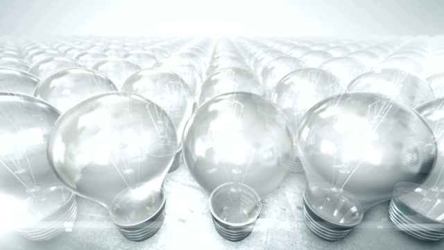 Camera movement over group of lightbulbs (bright) - Loop video
