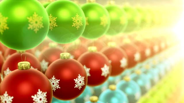 Camera movement over multi-colored christmas ornaments video