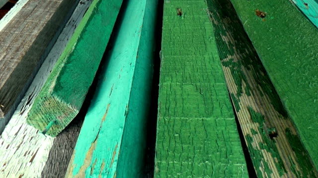 Camera moves along aged boards, painted in green video