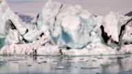 camera moves along big icebergs at Jokulsarlon Iceland  close-up video
