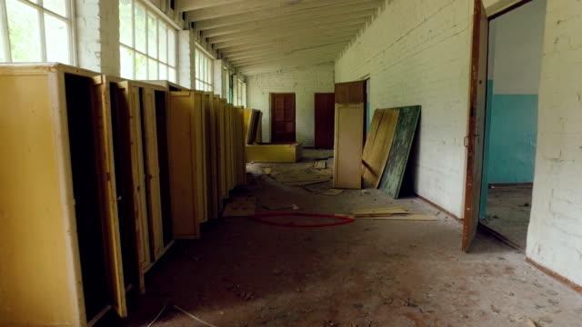 camera moves inside old abandoned and devastated building, broken furniture, garbage video