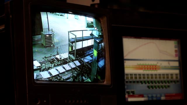 Camera screen in the factory, The conveyor on the screen of the monitor video