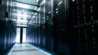 Camera Walkthrough Shot of a Working Data Center With Rows of Rack Servers. video