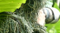 camouflage photographer in the ghillie suit video
