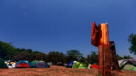 Camp Site under moonlight nightsky timelapse in motion video