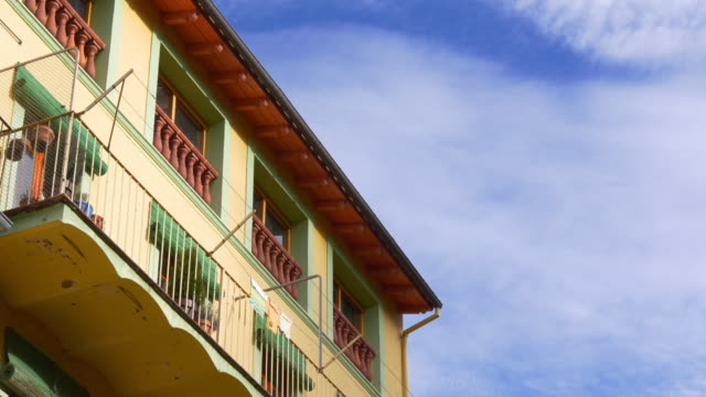 camprodon colored house blue cloud sky 4k spain video