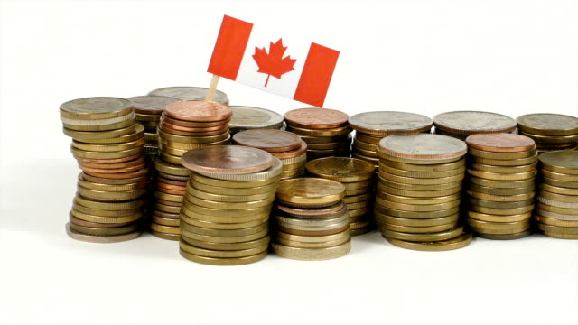 Canada flag with stack of money coins video