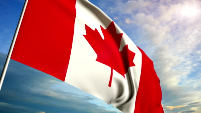 Canadian flag floating on sunset sky background video