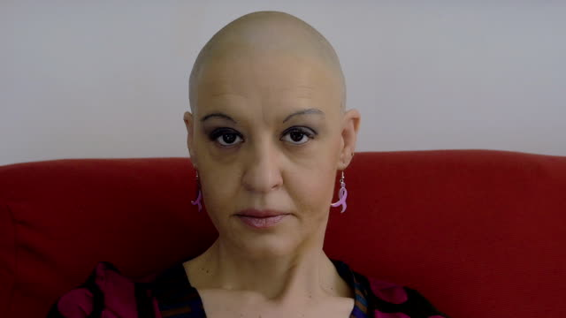 cancer survivor sitting on the couch: bald, loneliness, courage, faith, dise video
