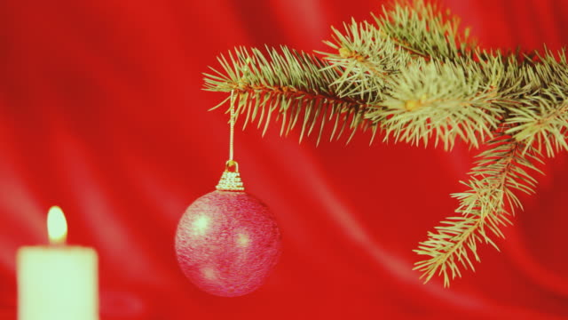 Candle and christmas ball on the branch video