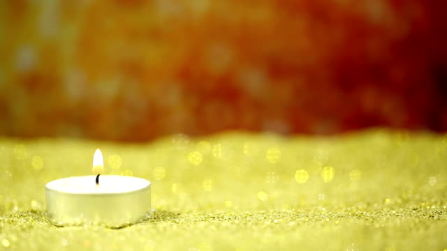 Candle and glitter background video