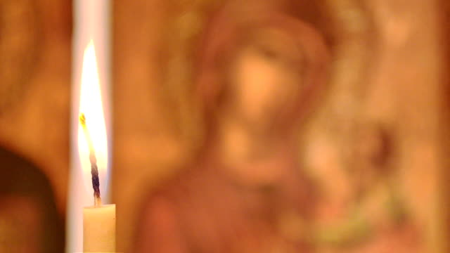 Candle in the background of the icon of the Virgin Mary video