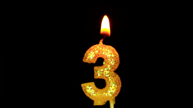 Candle in the form of three video