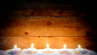 candle light on wooden background with snow video
