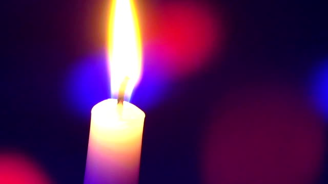 candle on a colored background moving video