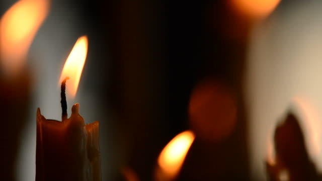 Candle with candles defocused in background video
