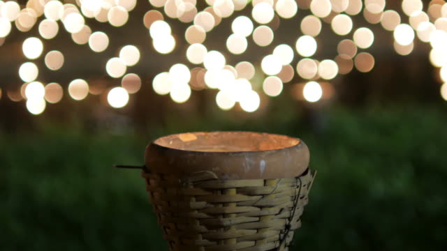 Candle with circle light bokeh for background footage design video