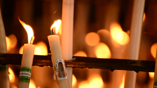 Candles at candlestick in church video