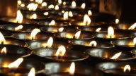 Candles Burning in Buddhist Temple video
