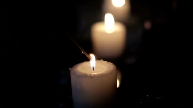 Candles in an abandoned building. Slow motion video