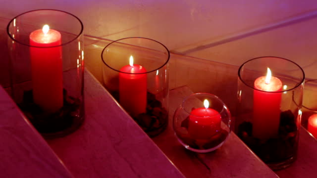 Candles in glass flasks video