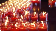 Candles in red transparent chandeliers video