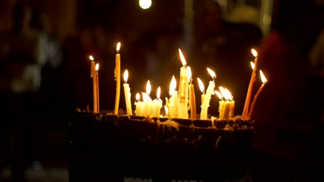 Candles in the Holy Sepulchre Church in Jerusalem video