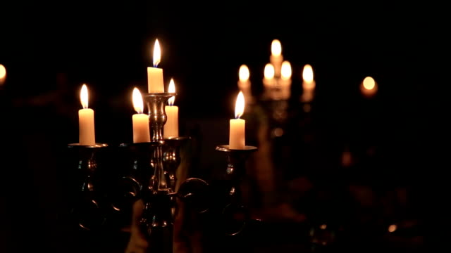 Candles in vintage candlestick in a dark interior video