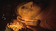 candles lighting with buddha image in Bagan, Myanmar video