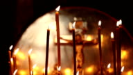 Candles on the background of Jesus Christ video